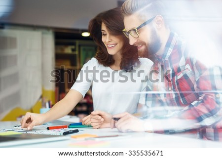Creative designers working at office. Creating new web desing - stock photo