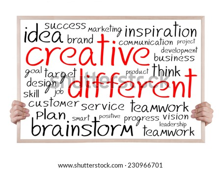 creative different and other related words handwritten on whiteboard with hands - stock photo