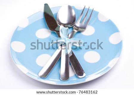 Creative dinner set (plate, fork, knife) - stock photo
