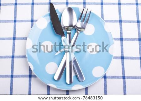 Creative dinner set (plate, fork, knife, spoon) - stock photo