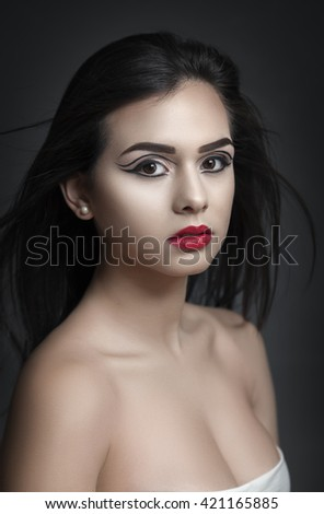 Creative fashion beauty makeup of an attractive young woman. - stock photo