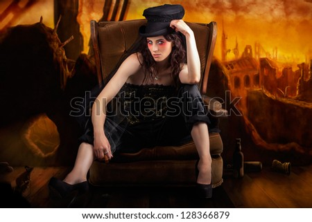 Creative Fine Art Photo Illustration Of An Elegant Fashion Model Sitting In A Rocking Sofa Chair While Ruling The Murky Underground Fashion Scene. On Hand Drawn Background - stock photo