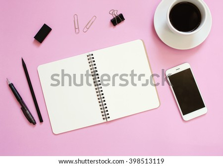 Creative flat lay mockup design of workspace desk with blank notebook, smartphone, coffee, stationery with copy space background   - stock photo