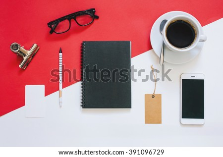Creative flat lay photo of workspace desk with smartphone, eyeglasses, coffee, tag and notebook with copy space background, minimal styled - stock photo