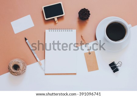 Creative flat lay photo of workspace desk with stationery, coffee and blank notebook with copy space background, minimal styled  - stock photo