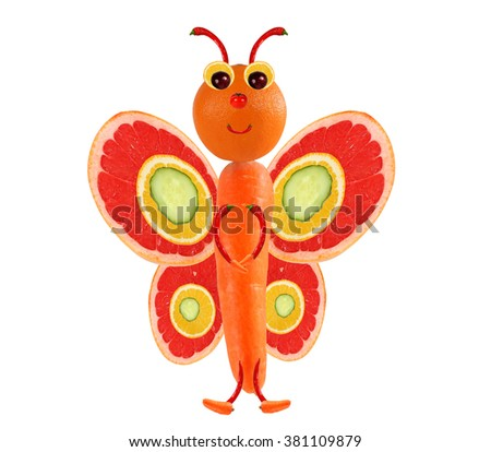 Creative food concept. Funny little butterfly made of fruits and vegetables. - stock photo