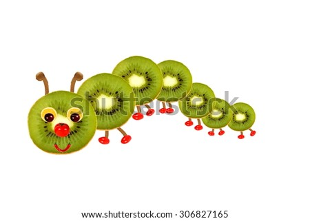 Creative food concept. Funny little  caterpillar made from fruit and vegetables - stock photo