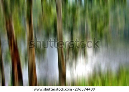 Creative forest motion blur abstract background - stock photo