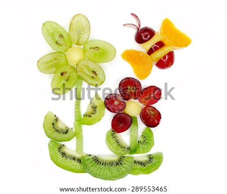 creative fruit dessert for child funny form bee gathering pollen on the flower - stock photo