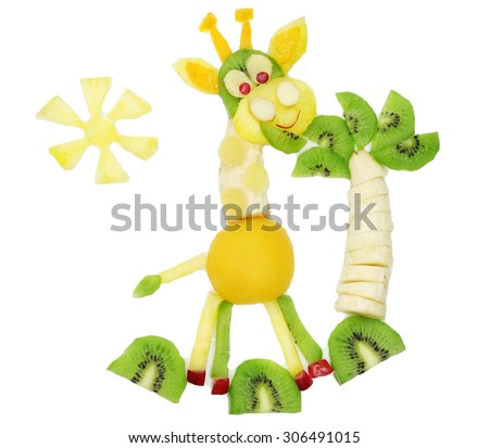 creative fruit dessert for child funny form giraffe eating palm leaves - stock photo