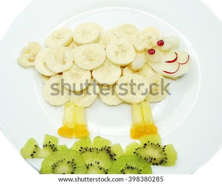creative fruit dessert for child funny form ship animal - stock photo