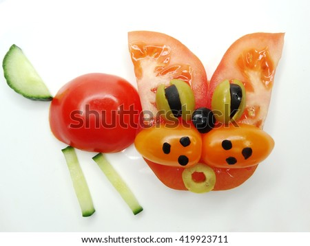 creative funny vegetable food snack with tomato cat form - stock photo