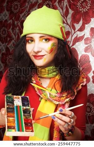Creative girl. Portrait oj young artist. - stock photo