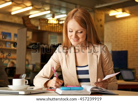 Creative girl working with palette in office