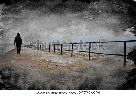 Creative grungy textured image of lonely person walking on pier. - stock photo