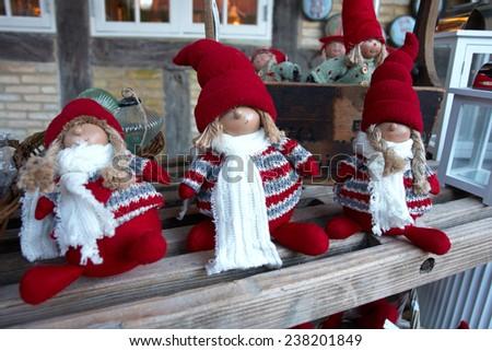 Creative handmade Christmas dolls in a market fair                                - stock photo