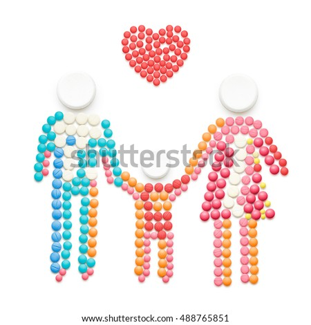 Creative healthcare concept made of drugs and pills, isolated on white. Family holding hands.