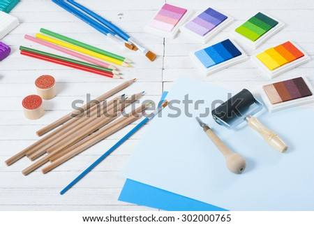 creative hobby tools on white wood