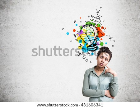 Creative idea concept with thoughtful african american woman and colorful lightbulb sketch on concrete background - stock photo