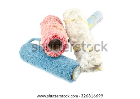 creative image of dirty and reused white,red and blue roller paint brush isolated on white background
