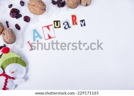 Creative January composition, snowman, snow, walnuts and dried cranberry, separate calendar page with copy space - stock photo