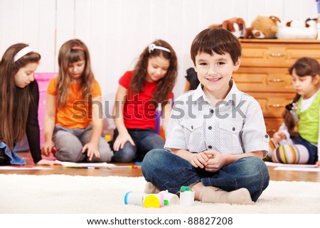 Creative kid plays with colorful dough - stock photo