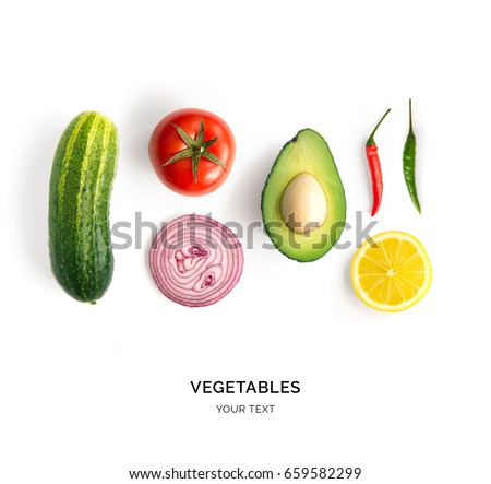 Creative layout made of avocado, onion, tomatoes, pepper and lemon. Flat lay. Food concept. Vegetables isolated on white background.