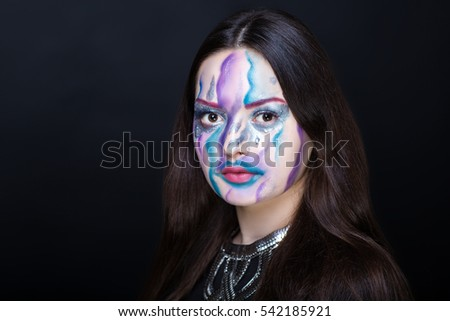 Creative make-up new conceptual idea. blue white bold faceart body art painting. Crazy new graphic abstract picture woman face surrealistic. professional photo. Creativity art lines conceptual winter
