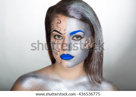 Creative make-up, new conceptual idea for cosmetics shop or Halloween. Silver black blue bold crazy body art painting. Wanderer with mechanical parts of puzzle, gears, metal fragments. Painted hairdo