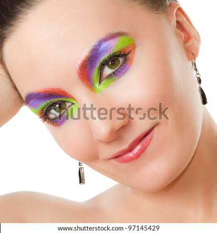 Creative makeup woman. Sexy model woman with colored cosmetics on white background