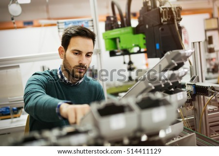 Creative mechanical engineer working on machines