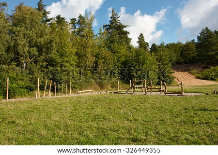 Creative modern playground made of wood in the middle of nature - stock photo