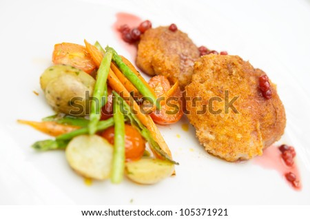 Creative nuggets with stir fried vegetables on plate close-up