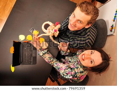 Creative people working in office on new clothes collection - stock photo