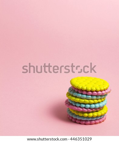 Creative photo of crackers covered with paint on pink background. - stock photo