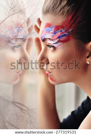 Creative Portrait of a beautiful girl at the window. Double exposure - stock photo