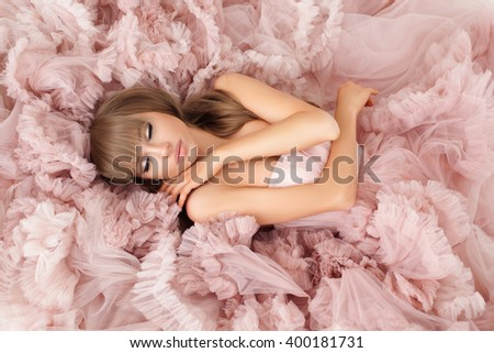 creative portrait of a fashion woman in gorgeous long pink dress - stock photo