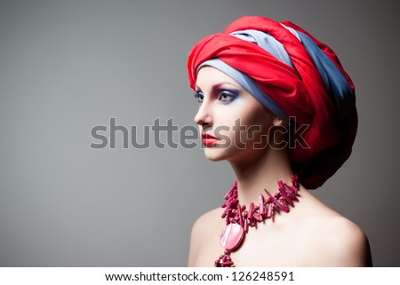 creative portrait of beautiful girl in a turban - stock photo