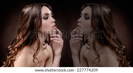 Creative portrait of beautiful woman. Reflection - stock photo