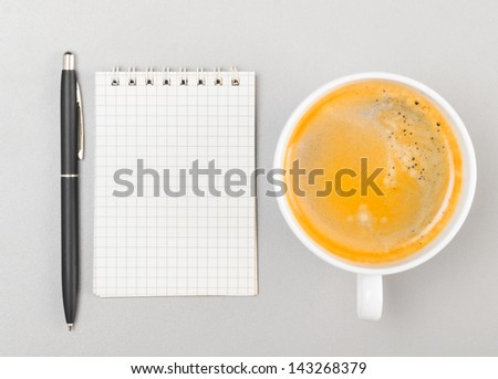 creative process. blank notebook and cup on gray - stock photo