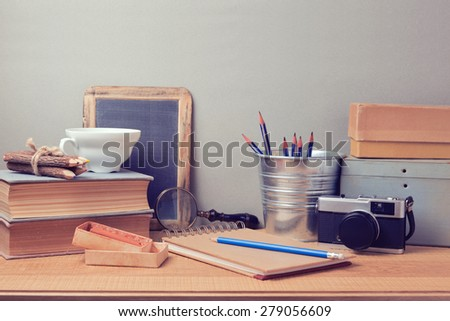 Creative process concept. Retro artistic objects on wooden desk - stock photo