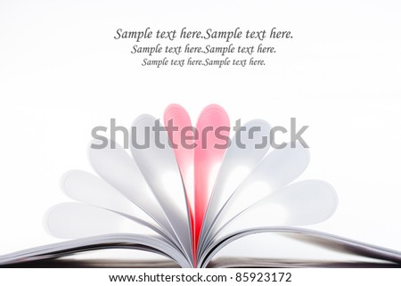 Creative red heart from white pages book on white background. - stock photo