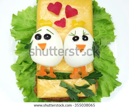 creative sandwich with cheese and boiled egg birds - stock photo