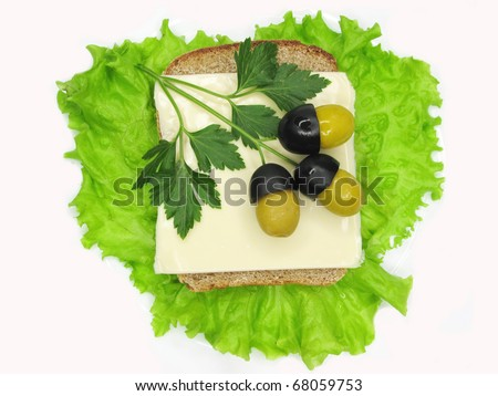 creative sandwich with cheese and oaks made of olives - stock photo
