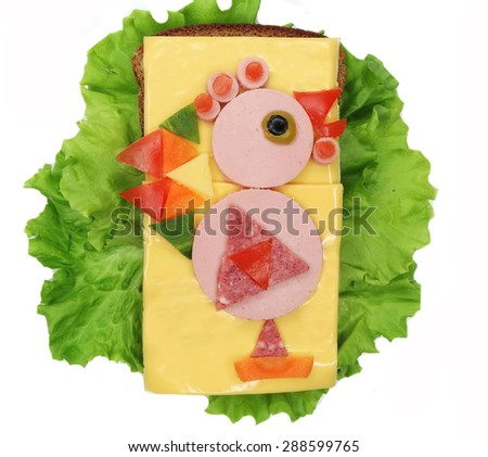 creative sandwich with cheese and salami cock bird form - stock photo