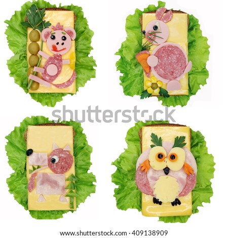creative sandwich with cheese and salami monkey form - stock photo