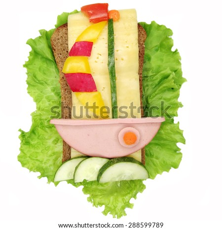 creative sandwich with cheese and salami ship form - stock photo