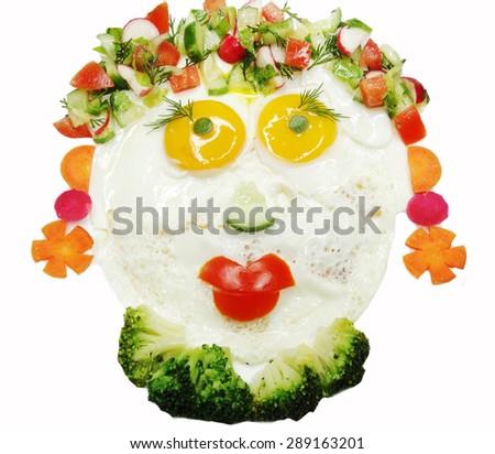 creative scrambled egg breakfast face shape - stock photo
