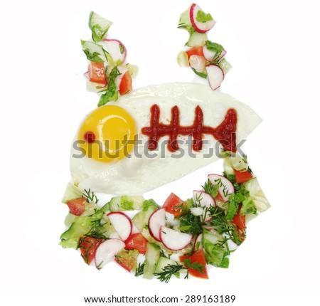 creative scrambled egg breakfast fish form - stock photo
