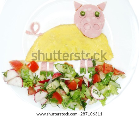 creative scrambled egg breakfast made of cooked omelet pig shape - stock photo